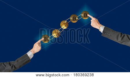 Set of gold bitcoins linked by chain on blue background with two arms pointing to ends to illustrate concept of blockchain for supply chain management