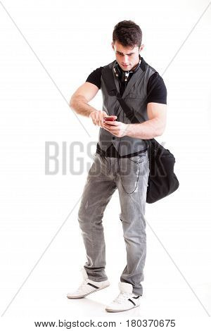 Full length portrait school boy phone isolated on white surprised teenager get sms