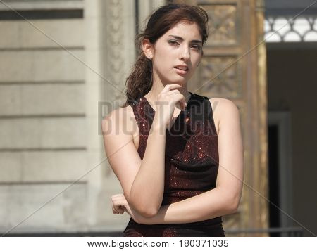 Woman Thinking Or Wondering Wearing A Formal Red Dress