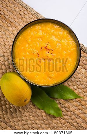 alphonso mango pulp or hapus aam ras or amba ras in marathi, selective focus