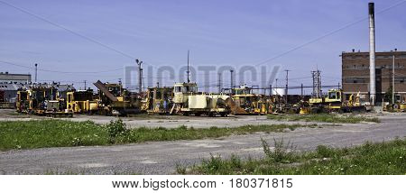 Montreal, Quebec, August 20, 2016 - Panoramic view of an old railroad bone yard with a variety of work vehicles and parts in the CP Rail Train Yards in Cote Saint Luc in Montreal, Quebec on a sunny day in August.