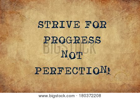 Inspiring motivation quote with typewriter text strive for progress not perfection. Distressed Old Paper with Typing image.