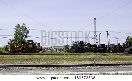 Montreal, Quebec, August 20, 2016 - Wide view of an old locomotive and work engine in the CP Rail Train Yards in Cote Saint Luc in Montreal, Quebec on a sunny day in August.