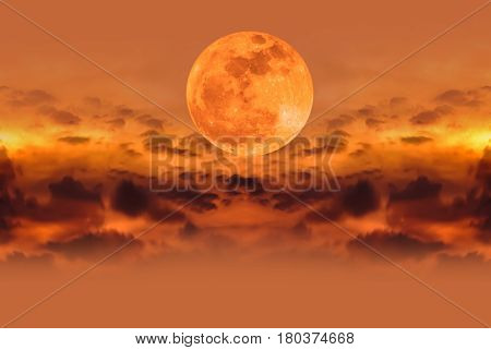 Supermoon on orange nature background. Attractive photo of night sky and silhouette of clouds. Outdoor at the nighttime. The moon were NOT furnished by NASA.