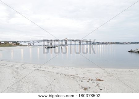Chesapeake Bay Bridge Virginia With Sandy Beach in Foreground.