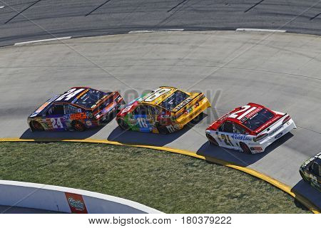 April 02, 2017 - Martinsville, Virginia, USA: Chase Elliott (24) leads Kyle Busch (18) and Ryan Blaney (21) during the STP 500 at Martinsville Speedway in Martinsville, Virginia.