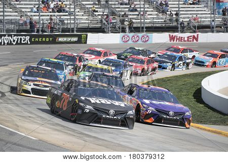 April 02, 2017 - Martinsville, Virginia, USA:  Martin Truex Jr. (78) brings his race car through the turns during the STP 500 race at the Martinsville Speedway in Martinsville, Virginia.