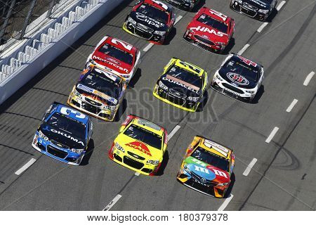 April 02, 2017 - Martinsville, Virginia, USA: Austin Dillon (3), Dale Earnhardt Jr. (88) and Kyle Busch (18) battle three wide during the STP 500 at Martinsville Speedway in Martinsville, Virginia.