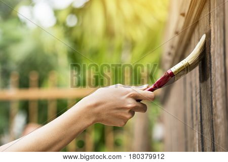 Applying protective varnish on a wooden texture