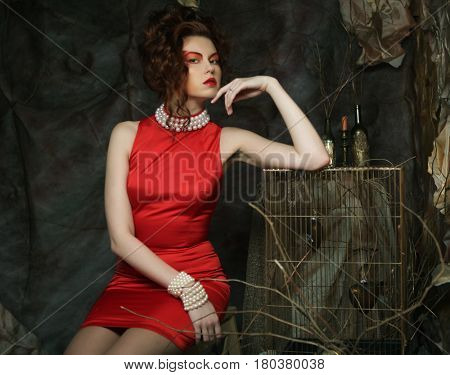 young woman with creative visage wearing  red dress