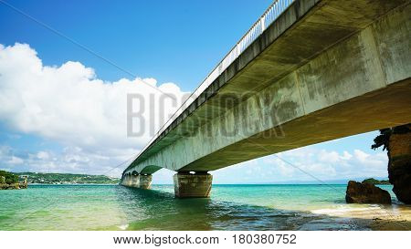 Sightseeing View of The Kouri Bridge with blue sky one of the very long bridge in Okinawa Japan.