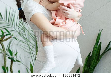 Pregnant women with daughter pregnancy belly of woman with child. Happy motherhood. Expecting baby birth in third trimester being mother. Prenatal period pregnancy health prepared for child birth