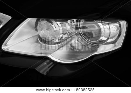 motor-car headlights on a black background