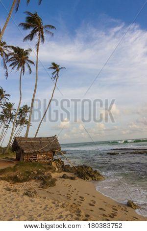 Old hut on the beach Mirissa Sri Lanka vertical view