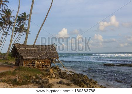 Old hut on the beach Mirissa Sri Lanka horizontal view