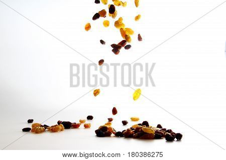 Raisin / A raisin is a dried grape. Raisins are produced in many regions of the world and may be eaten raw or used in cooking, baking, and brewing