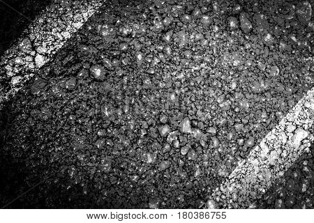 tar and stones of asphalt road  texture  background