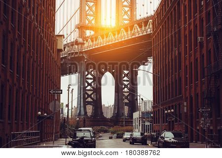 Sunset in New York City. Dumbo area with Manhattan Bridge scenic view.