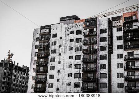 Building under construction, apartment buildings, construction crane, high-rise building, multi-storey building