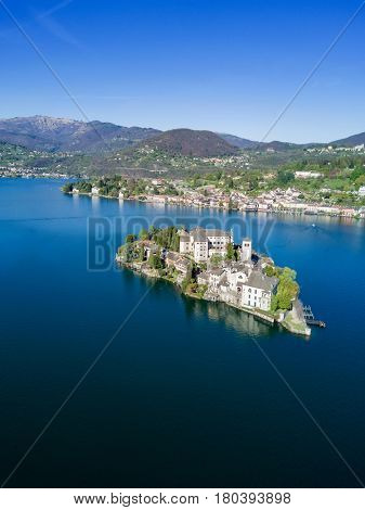 Aerial view of San Giulio Island and the village of Orta San Giulio. The island is situated in Orta Lake in Piedmont, northwestern Italy, Europe.