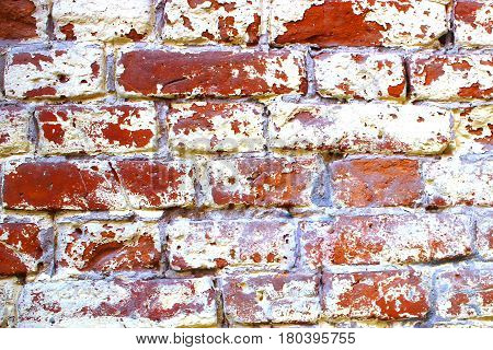 old brick wall texture , ancient building, destroyed by time Fragment  with white stucco