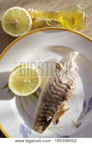 steamed sea bream fillet seasoned with oil and lemon