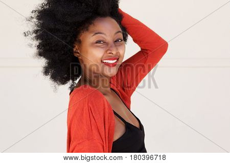 Smiling African Woman With Hand In Hair