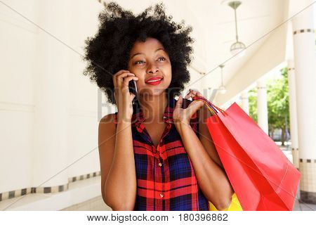 Beautiful Woman Walking With Mobile Phone With Shopping Bags