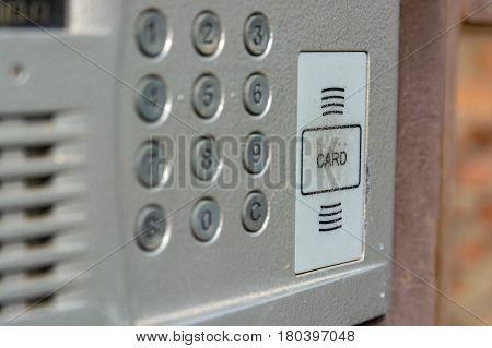 Closeup of grey door entry device on front door