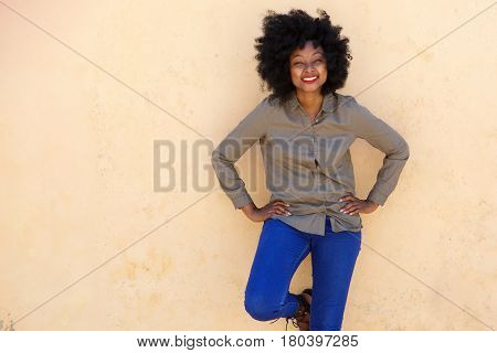 Beautiful Woman Leaning On Wall And Laughing