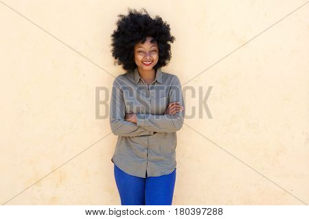 Beautiful Young Woman Standing And Smiling With Arms Crossed