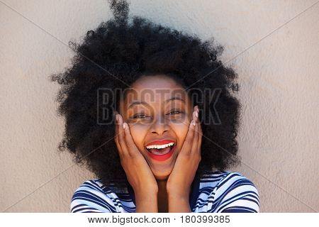 Ecstatic Woman With Head In Hands