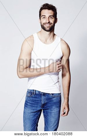Happy man in white vest portrait studio