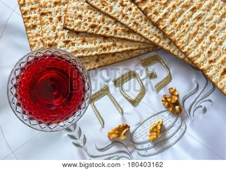 Traditional food and drinks - matzo, wine and walnuts for Jewish Passover celebration