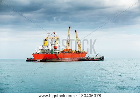 Marine and shipping unloading in the ocean.