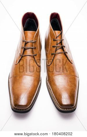 Front view of brown chukka boots on a white background