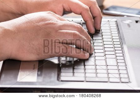 Adult Mans Hand On The Keyboard Of Lap Top