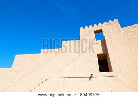 In Oman    Muscat    The   Old Defensive  Fort Battlesment Sky And  Star Brick