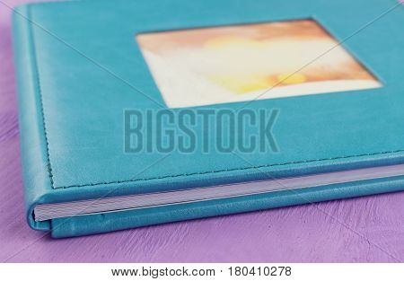 Family photo album. Photo book from color eco-leather.