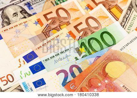 Background of different currency. Euro banknotes and american dollars