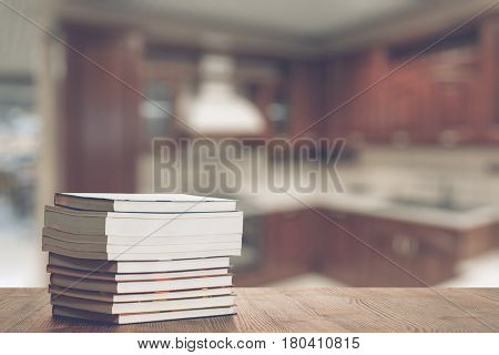 stack of cookbook on old wooden table in the kitchen