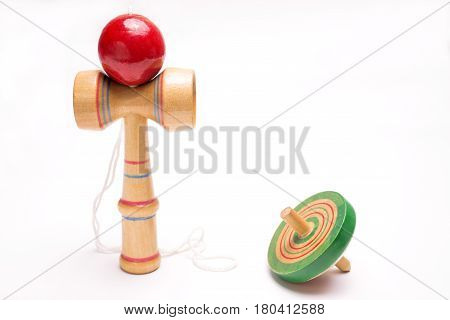 Kendama(ball and cup) and Koma(spinning top) on white background