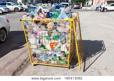 Samara Russia - September 7 2016: Container for collecting plastic bottles of various drinks for recycling on the city street in summer sunny day