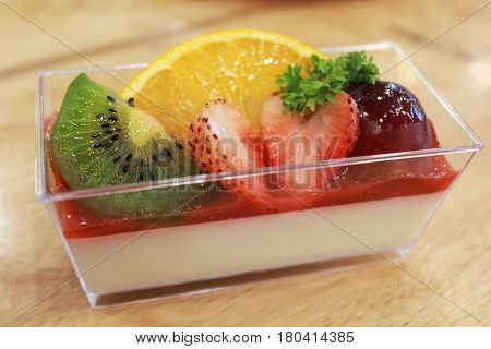 delicious dessert panna cotta in a glass and fresh fruit