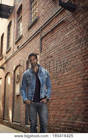 Denim jacket man by building in street portrait