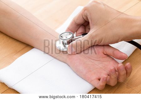 Chinese Doctor checking patients pulse rate