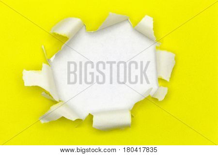 Yellow ripped open paper on white paper background