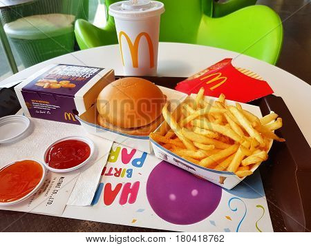 CHIANG RAI THAILAND - MARCH 1 : fish burgers french fries soft drink and nuggets on table at McDonald's restaurant on March 1 2017 in Chiang rai Thailand
