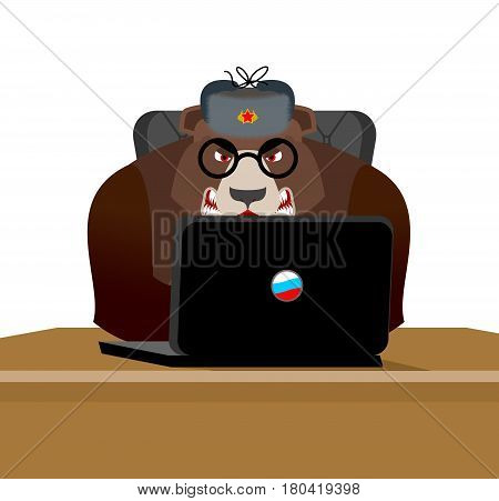 Russian hacker. Bear and laptop. IP technology in Russia. Wild beast in fur hat
