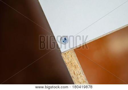 Close-up Of The Screw In A Chipboard Furniture